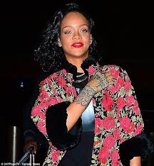 rihanna wears floral coat after getting new tattoo as she travels