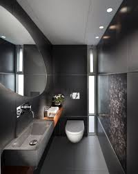 small space grey bathroom with oval white acrylic tub plus assorted
