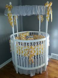 modern white round baby crib with amazing gray themed canopy