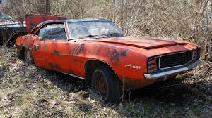 rare muscle cars michigan junkyard turns up some buried muscle car treasure