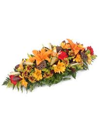 cornucopia arrangements cornucopia table centerpiece with lilies and daisies