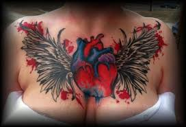 heart and wings chest piece tattoo by candicethetattooist on