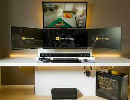 ultimate black and gold gaming setup four displays an amazing