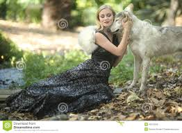 lovely woman posing with wolves outdoors stock photo image 43313329