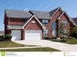 three car garage red brick home with three car garage royalty free stock image