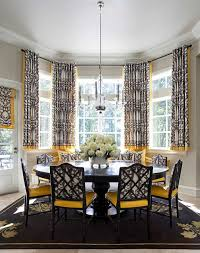 dining room bay window covered with short curtains and furnished