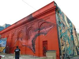 mural madness st petersburg s street art is a trip houston a mural by shark toof in an alley behind the state theatre