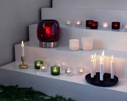 a range of stunning iittala candle and firelights to bring a