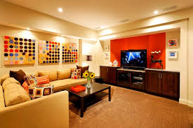 cheerful family room with orange and cream painting color for
