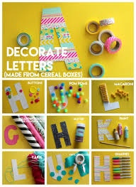 kid crafting monogram letters from cereal boxes a and a