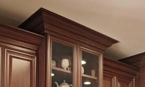 white kitchen cabinets with wood crown molding getting edgy with the history of crown molding