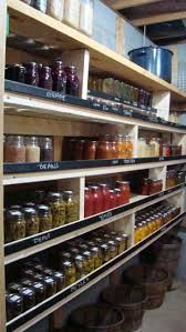 20 best images about o r g a n i z e on pinterest potato storage basement canning pantry idea the that help keep the canning jars from falling are painted with chalkboard paint then you can label each section with what