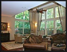 Window Treatment Hardware Medallions - 2 story stripe drapes engineered to hang from medallion shelves