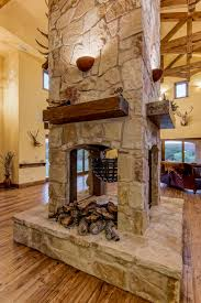 the wood burning fireplace with its four sided design is a