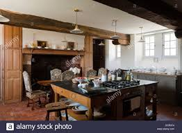 island hob unit in kitchen with wooden ceiling beams and large