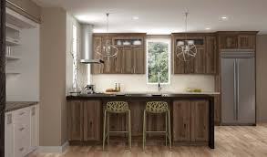 gray brown stained kitchen cabinets kitchen stories a modern twist on hickory dura supreme