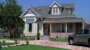 house with a wrap around porch day e quaint two house house wrap around