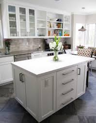 grey countertops connected by white wooden floating kitchen
