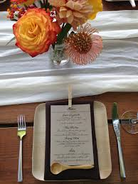 an outdoor wedding place setting using our compostable palm leaf