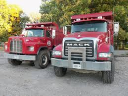mack dump truck 2 red mack dump trucks at the corner of elm st u0026 northwestern this