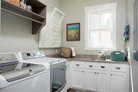 wall mounted cabinets for laundry room wall mounted clothes rack laundry room contemporary with built in