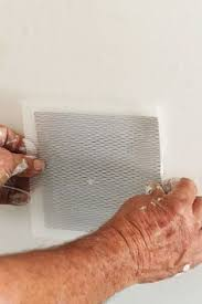 Repair Ceiling Hole by How To Repair A Hole In Your Ceiling Drywall Gaping Hole