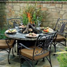 outdoor dining table fire pit with round patio and stoned tiles