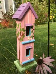 whimsical hand painted birdhouse cottage with white picket fence