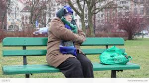 poor homeless woman sitting on the park bench stock video footage