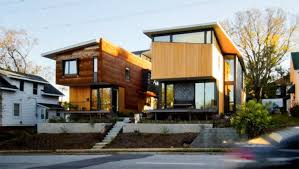 two homes two compact modern homes fill challenging empty lots in an