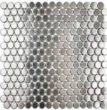 stainless steel penny round tile with  from remodelistacom
