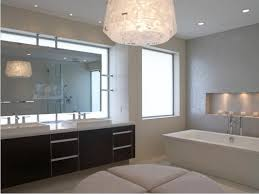 bathroom mirror with lights behind black pattern marble sink table