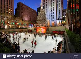 rockefeller center christmas tree and ice skating rink stock photo