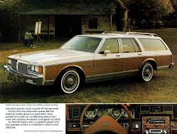 green station wagon with wood paneling pontiac parisienne brougham wagon pontiac safari 1977 89