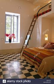black white checkerboard tiled floor in modern moroccan bedroom