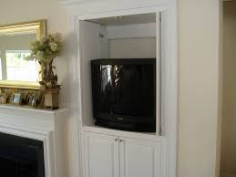 Tv Cabinet Doors Built In Wall Television Cabinet With Doors Next To Fireplace Of