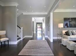hardwood floors grey walls white molding baseboards by