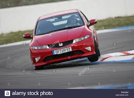 honda civic type r model year 2008 red driving diagonal from