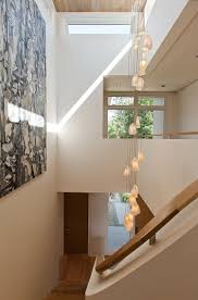inviting staircase with double height ceiling of unique naramata