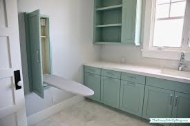 in wall ironing board contemporary laundry room with teal blue
