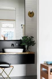 this victorian renovation is the definition of chic black white