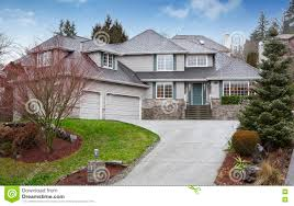 luxury two level house with garage and driveway stock photo