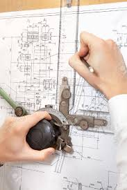 make a blueprint make hands making a project on blueprint by pencil stock photo