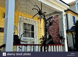cold spring ny halloween spider decorations hang from the porch