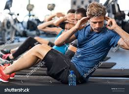muscular guy doing sit ups gym stock photo 654691078 shutterstock