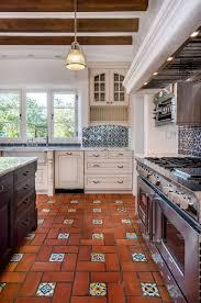 Red Tile Backsplash - traditional kitchen design using red tile floor color and