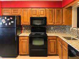 paint your oak kitchen cabinets outdated oak cabinets get a fresh look painted by payne