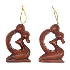2 ornaments of carved of suar wood a loving