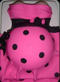 pregnant belly baby shower cake in bright pink and black dots png