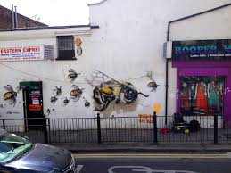 a london street artist paints swarms of bees on urban walls to bees 3